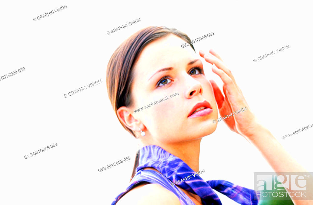 Stock Photo: Young woman touching her face.