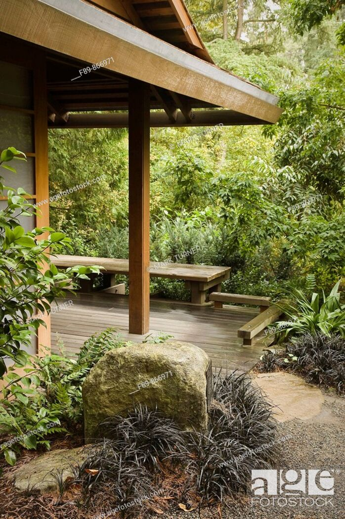Stock Photo: Gravel path bordered by Black Mondo Grass leads to Tateuchi Viewing Pavilion in Japanese garden.