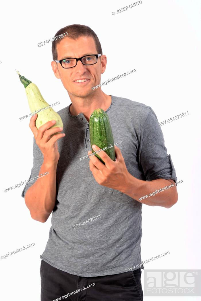 Stock Photo: portrait of a man with zucchini on white background.