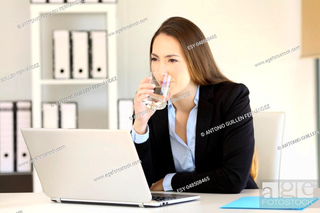 Stock Photo: Serious businesswoman drinking healthy fresh water at office.