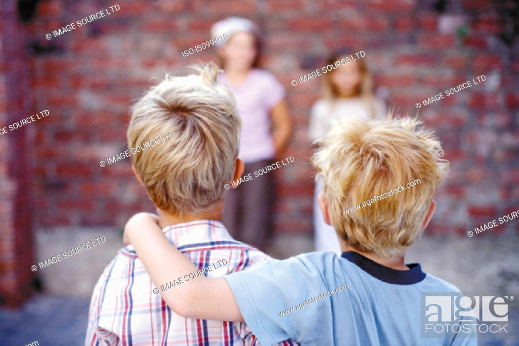 Stock Photo: Boys and girls facing each other.
