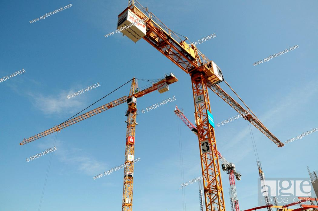 Stock Photo: Construction cranes of the company Liebherr at a construction site in Memmingen, Bavaria, Germany.