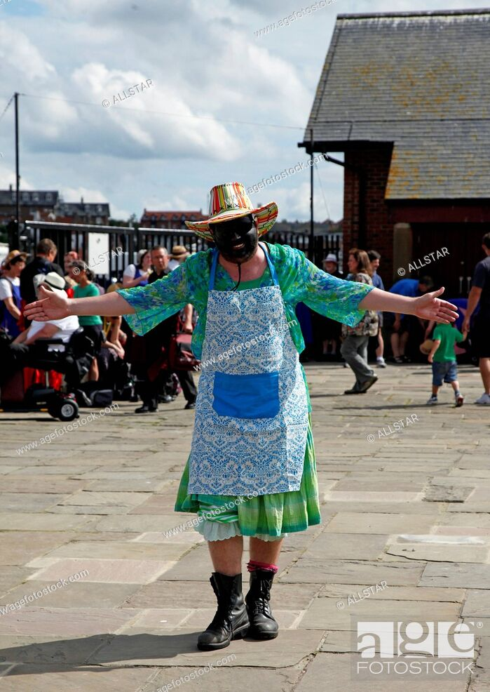 Stock Photo: AN OUSE WASHES MOLLY DANCER; WHITBY, NORTH YORKSHIRE, ENGLAND; 18/08/2012.
