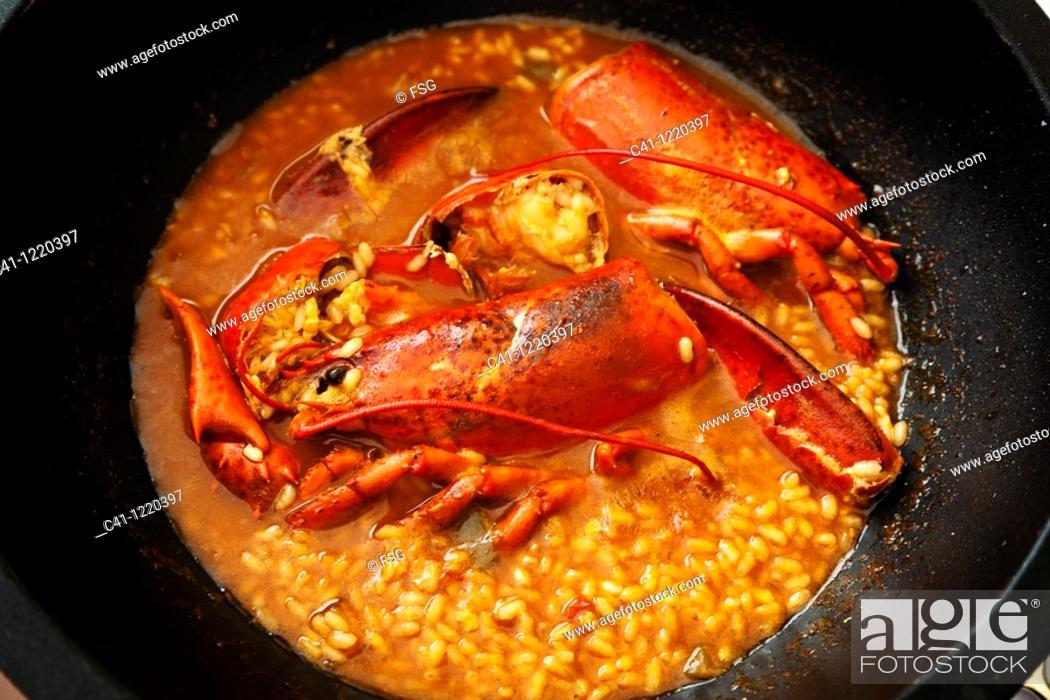 Stock Photo: Rice with lobster, Ebro river delta, Tarragona province, Catalonia, Spain.