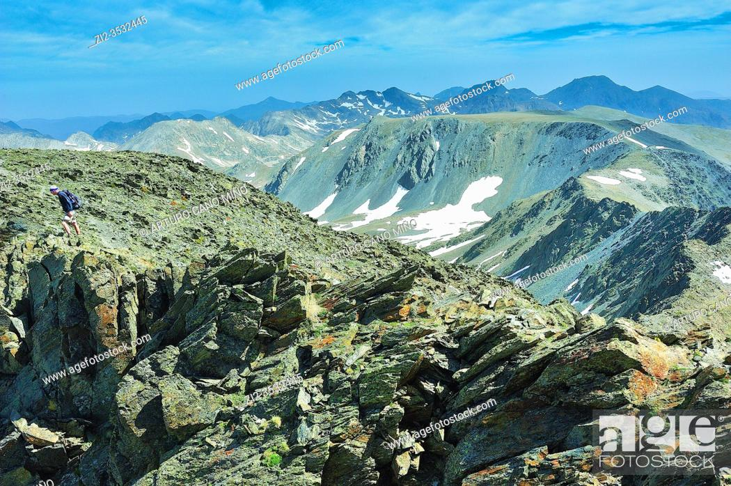 Stock Photo: View from the summit of Peak Carlit (2912 mts.). The Catalan Pyrenees Regional Natural Park in the French Pyrenees. Angoustrine-Villeneuve-des-Escaldes town.