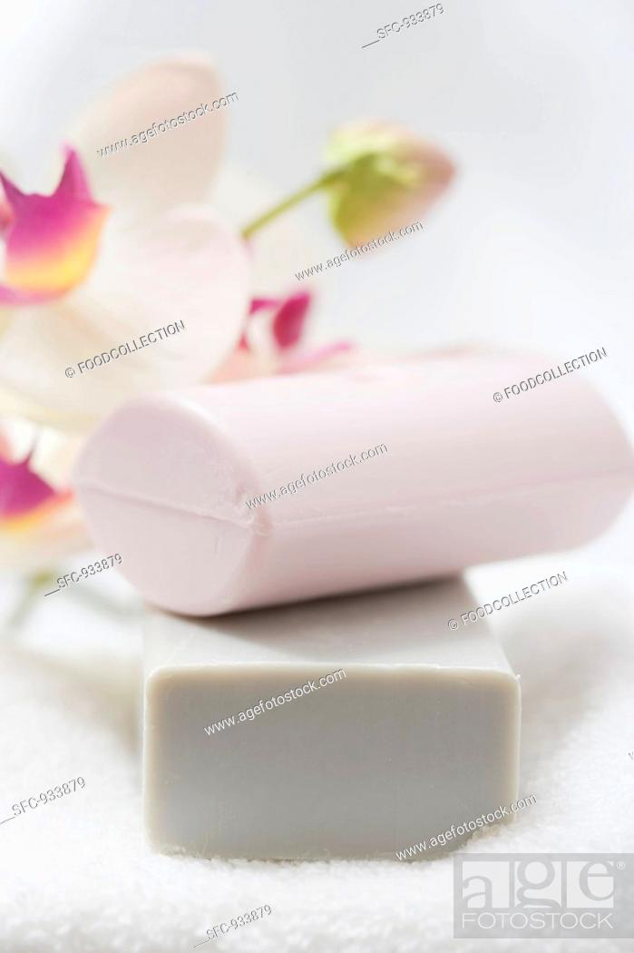 Stock Photo: Two soaps on a bath towel.