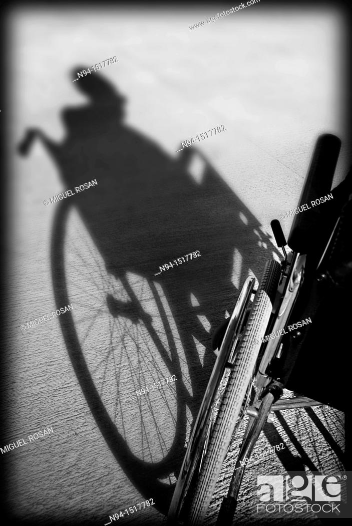 Stock Photo: Shadow on the floor of an old woman sitting in her wheelchair.