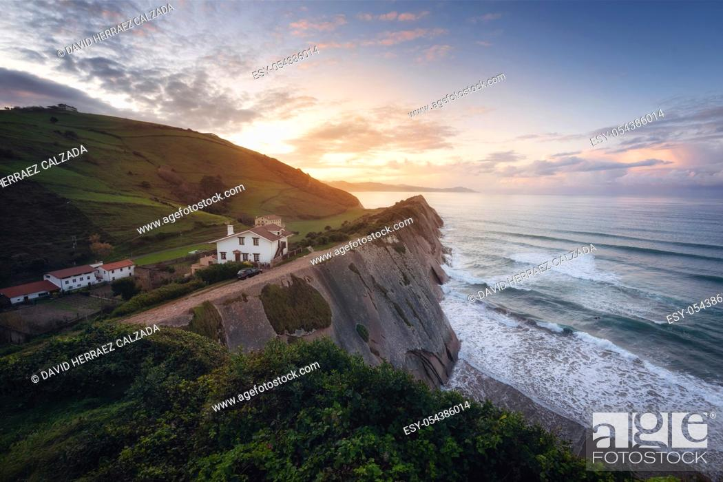 Stock Photo: Coast Landscape Of Famous Flysch In Zumaia at sunset, Basque Country, Spain. Famous Geological Formations .