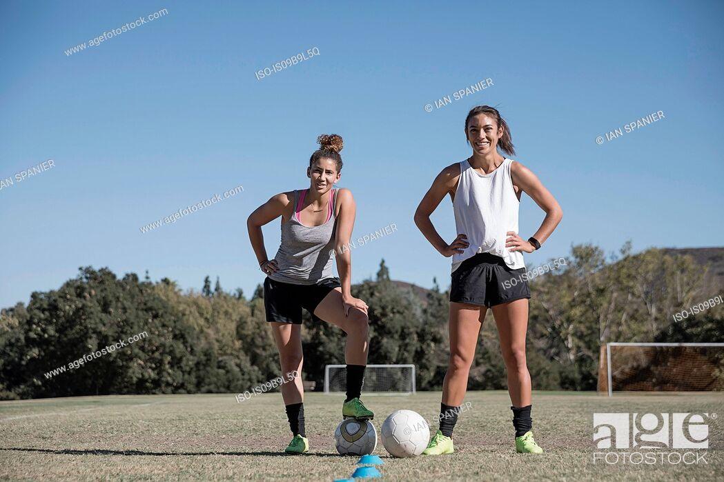 Stock Photo: Women on football pitch.
