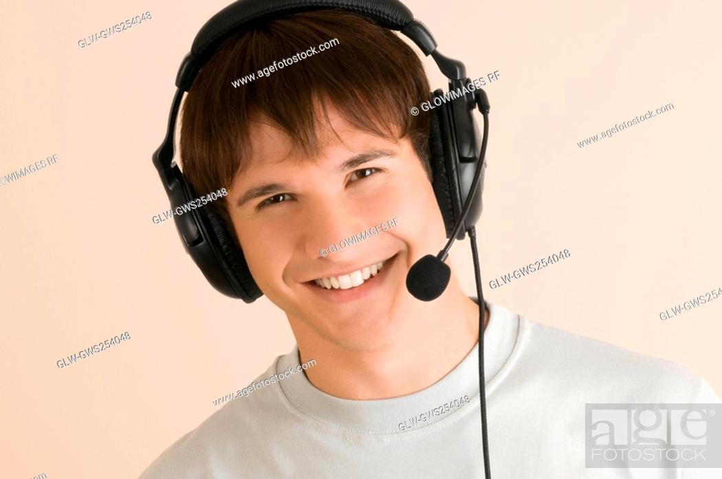 Stock Photo: Portrait of a young man listening to music.