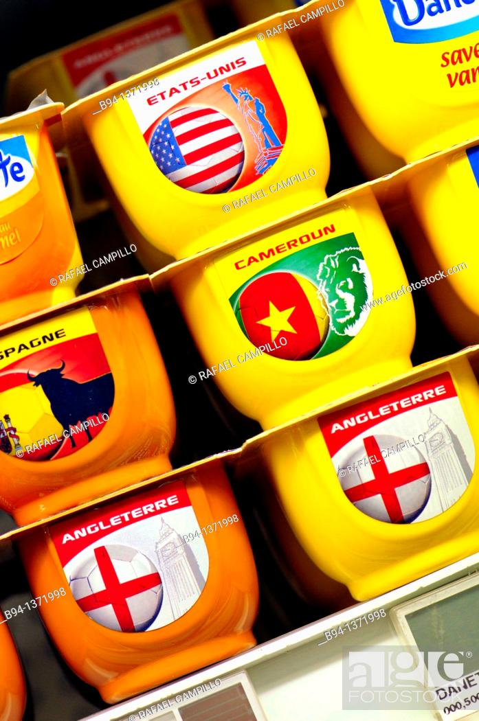 Stock Photo: Yogurts with flags from different countries in a supermarket, France.