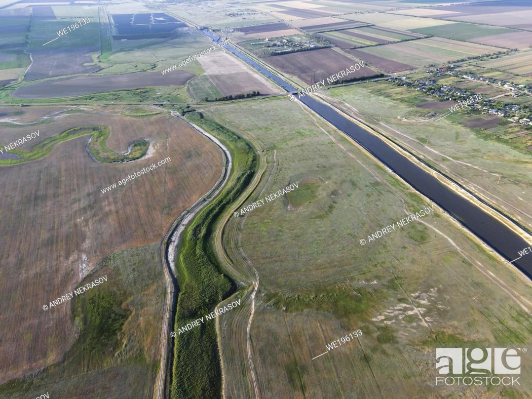 Stock Photo: SARATA RIVER, TATARBUNARY RAION, ODESSA OBLAST, UKRAINE - JULY 15, 2020: Aerial view on Sarata River.