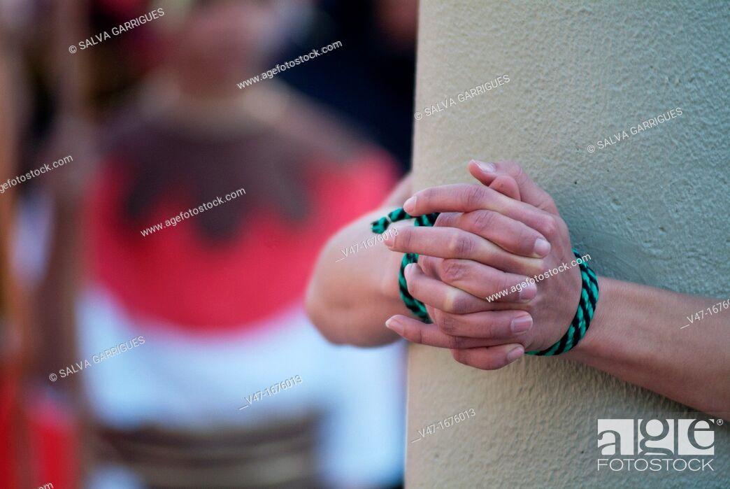 Stock Photo: man tied to a column, Alzira, Valencia, Spain, Europe.