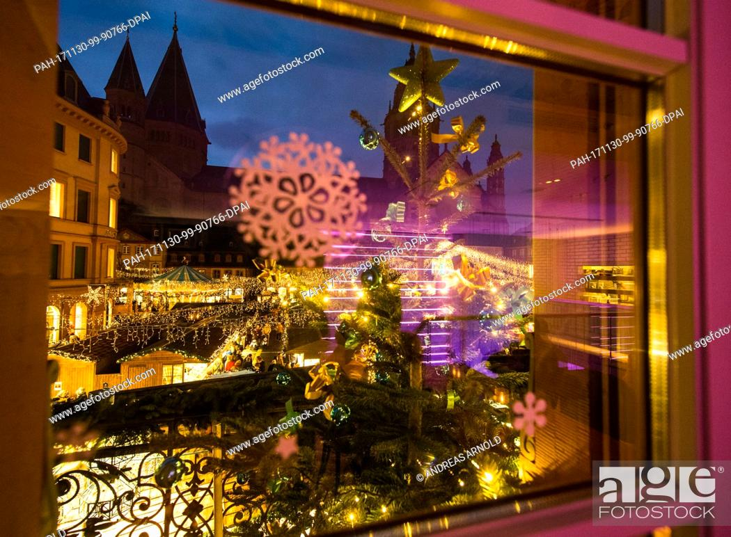 Stock Photo: View of the decorative lights during the opening of the Christmas market in Mainz, Germany, 30 November 2017. The Christmas market is open from 30 November to.