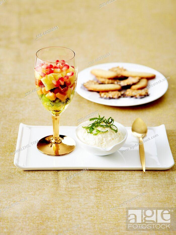Stock Photo: Lemon mousse, exotic fruit salad and crispy cookies.