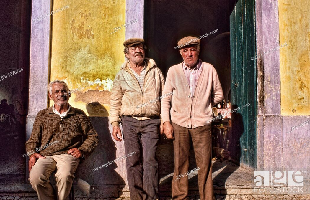 Stock Photo: Tough and rough old fishermen relaxing at a bar in the village of Olmao in the Algarve in Southern Portugal in Europe.