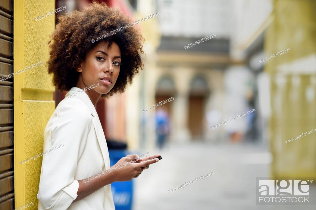 Stock Photo: Portrait of waiting young woman with cell phone.