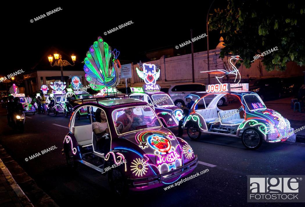 Colorful with LEDs illuminated cars, pedal car, Yogyakarta, Java