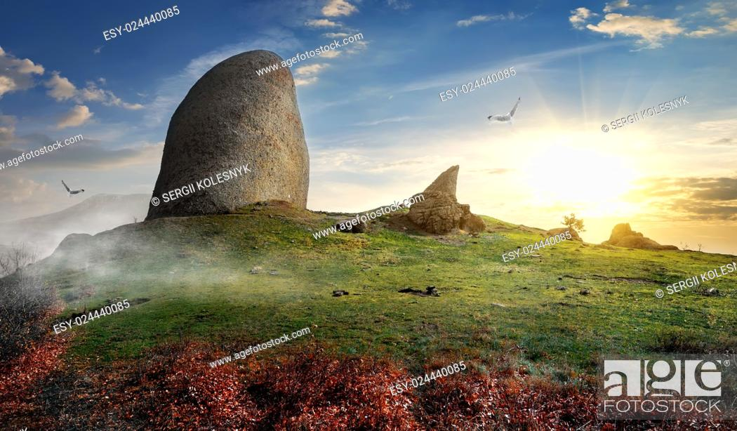 Stock Photo: Big stones on a mountain at sunset.