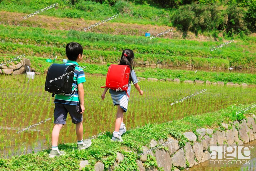 Stock Photo: School Kids Walking On Track.