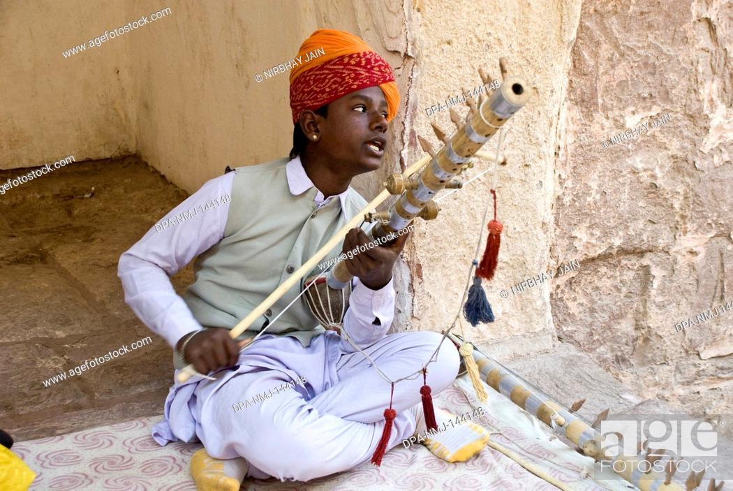 Stock Photo: Musician playing shehnai at Mehrang Garh fort at Jodhpur ; Rajasthan ; India NO MR.