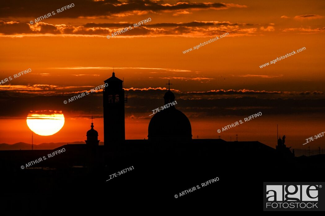 Stock Photo: Sunrise over Venice as cruise ship sails into port. Venice, Italy, Europe.