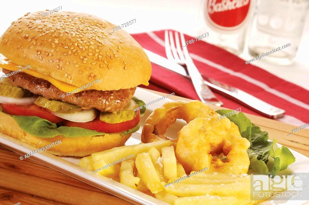Stock Photo: Cheese burger and chips with fried onion rings, food.