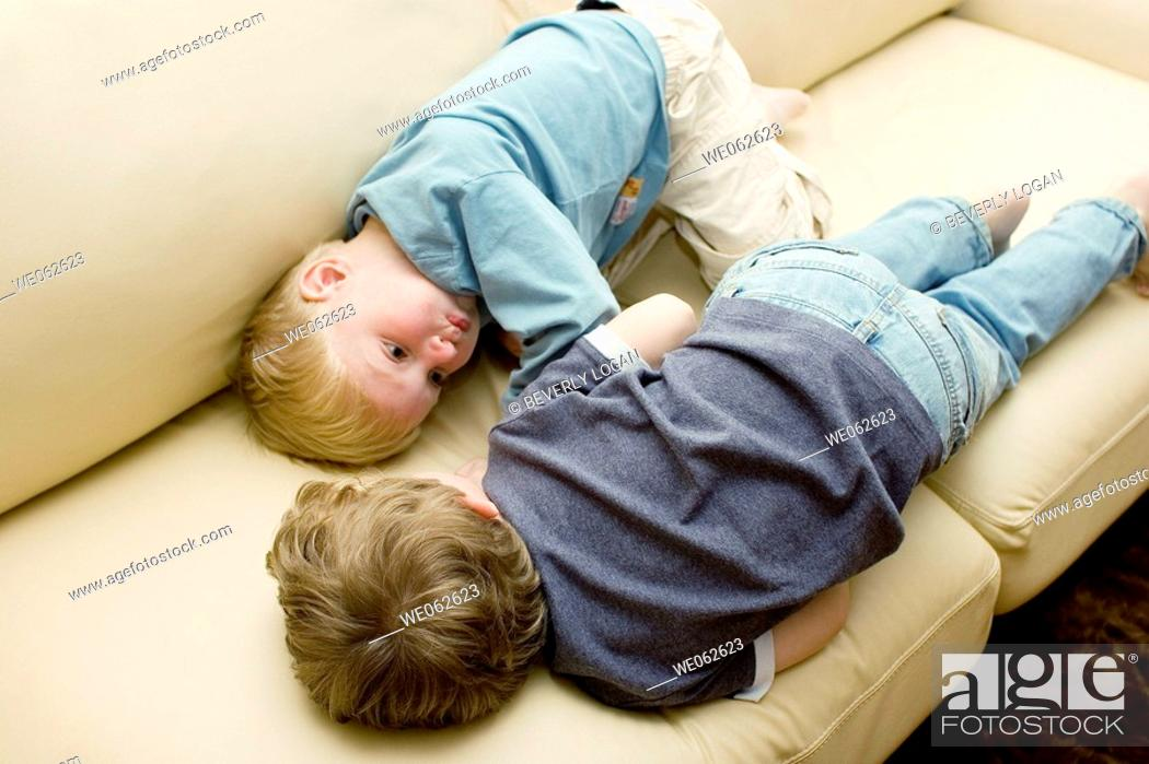 Stock Photo: Two four-year-old boys lying down and talking.