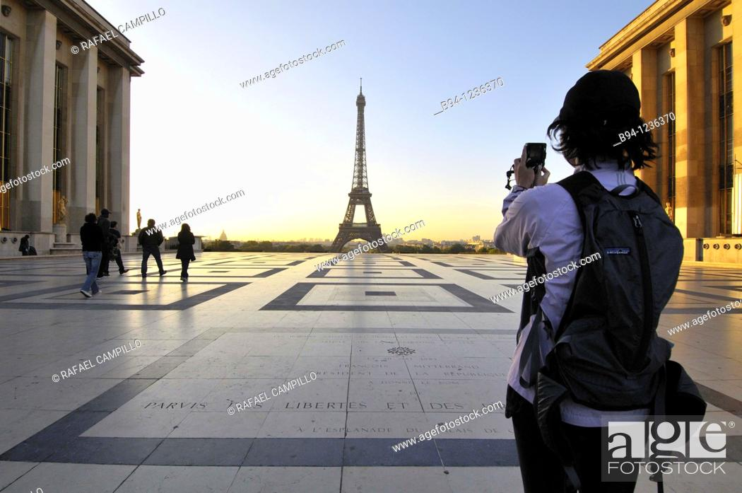 Stock Photo: Girl taking a picture. Eiffel Tower from the Terrace the Rights of Man of Chaillot Palace. Paris, France.