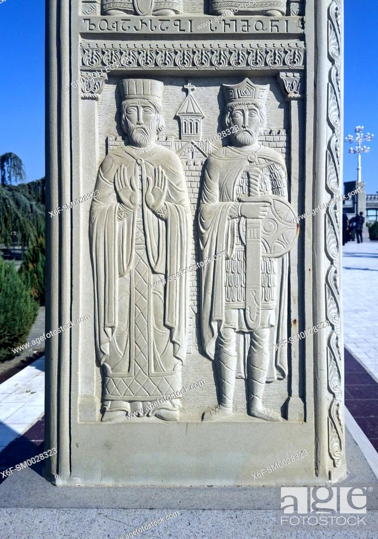 Stock Photo: Bas-relief depicting f. l. t. r. Saint Svimeon the Wonderworker and the Martyr Luarsab II, King of Georgia the on a cross pillar leading to the Holy Trinity.