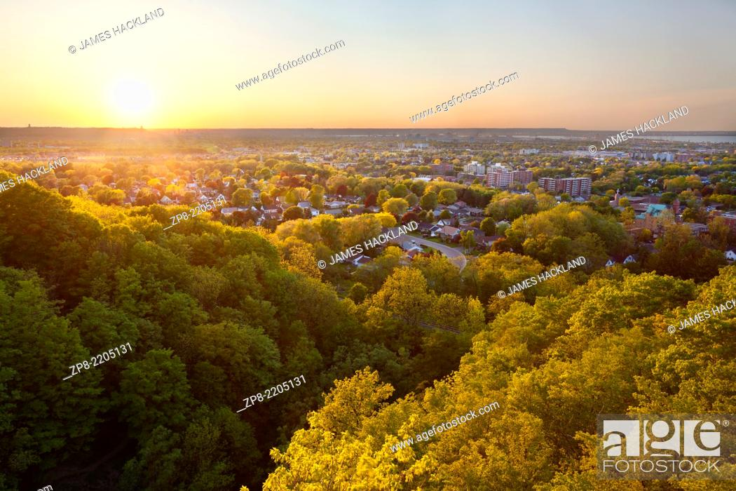 Stock Photo: A view of Southern Hamilton from a lookout near Devil's Punchbowl at sunset. Hamilton, Ontario, Canada.