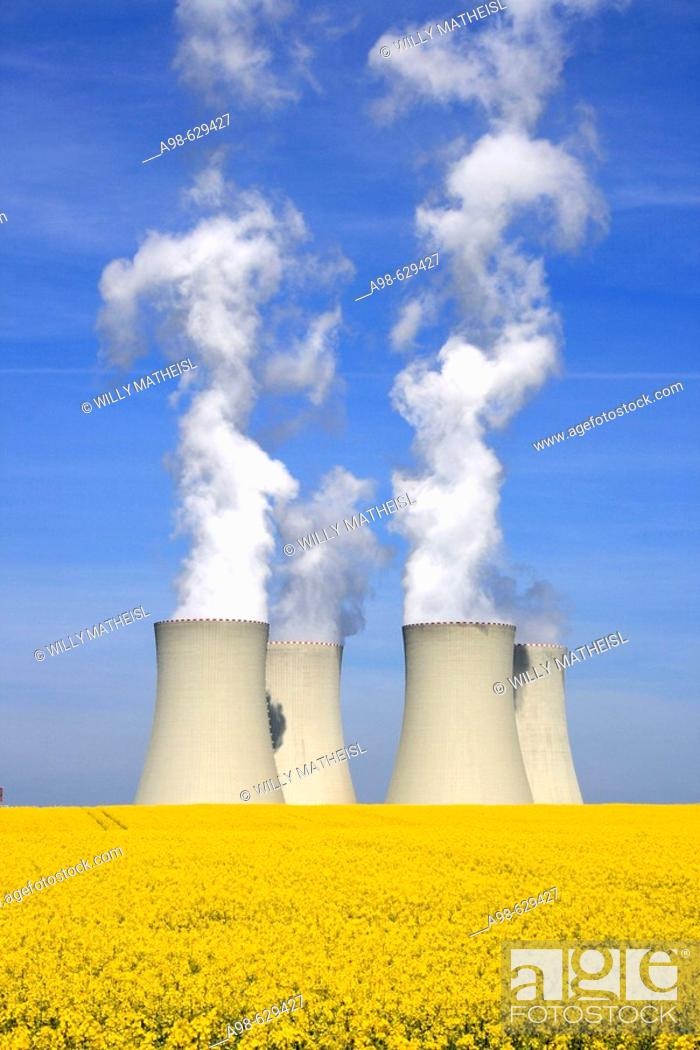 Stock Photo: Nuclear power station and rape field. Temelin. District of Budweis. South Bohemia, Czech Republic.