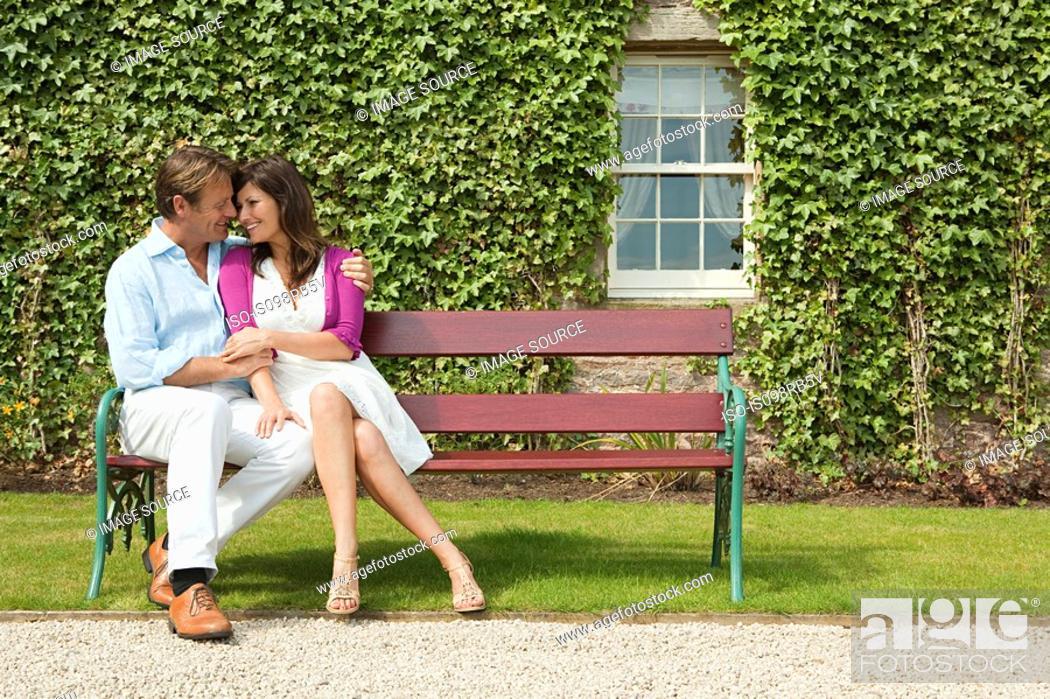 Stock Photo: Happy couple on bench.