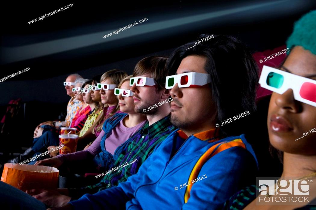 Stock Photo: Audience in cinema wearing 3D glasses, side view.