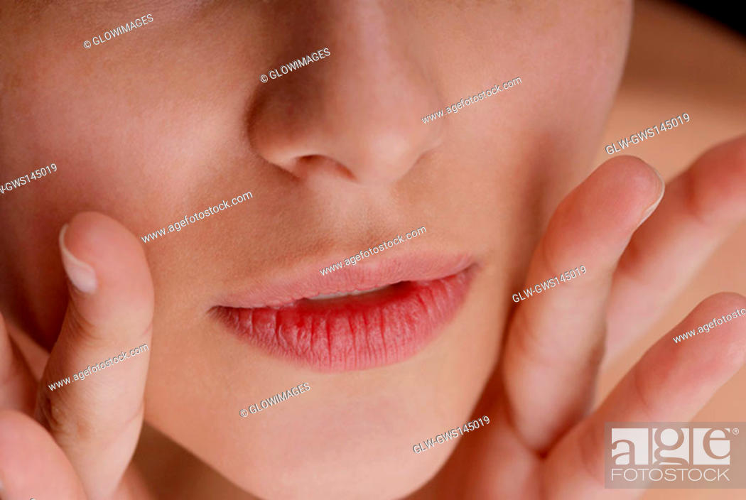 Stock Photo: Close-up of a young woman's lips.