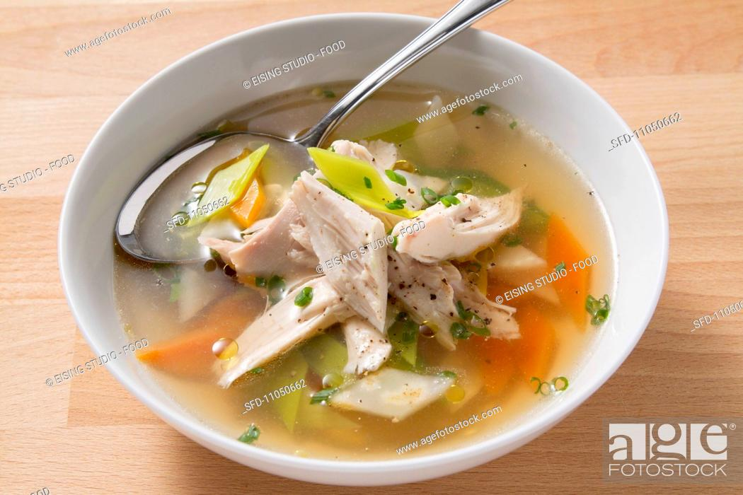 Stock Photo: Clear soup with chicken and vegetables.