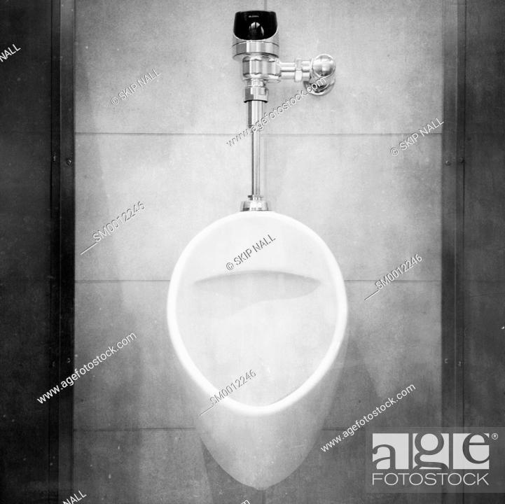 Stock Photo: A urinal in a men's bathroom.