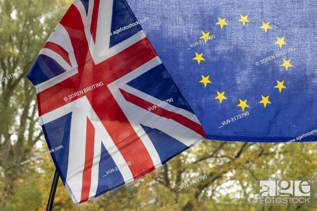 Stock Photo: UK flag and EU flag, juxtaposed as a symbol for BREXIT negotiations in autumn environment.