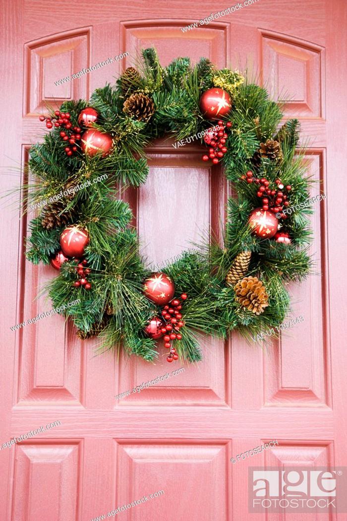 Stock Photo: Christmas wreath hanging on door.