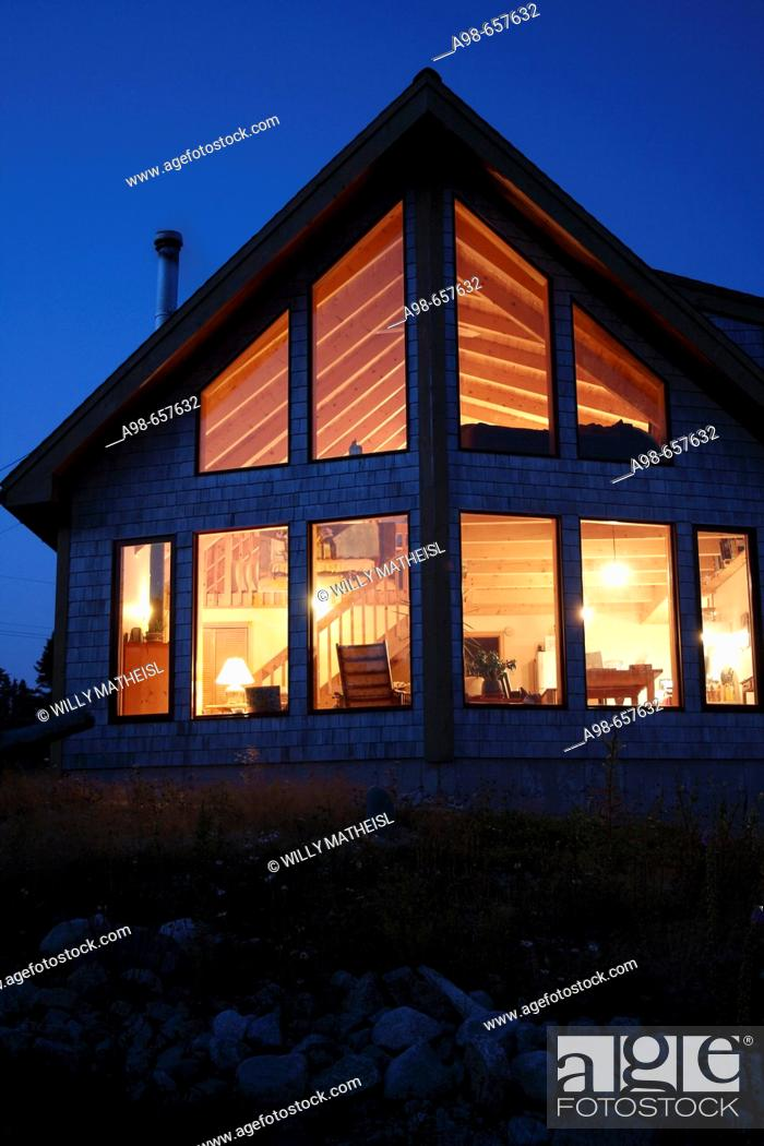 Stock Photo: Nova Scotia Canada, illuminated wooden summerhouse at dawn.
