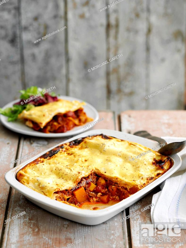 Stock Photo: Beef lasagne with carrot.