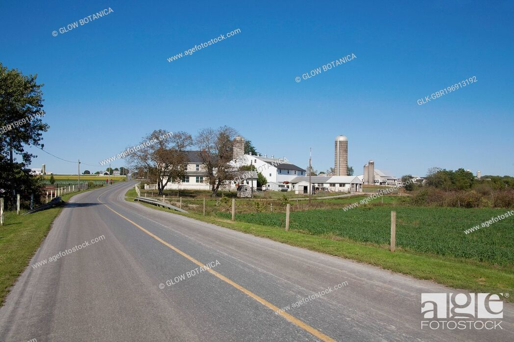 Stock Photo: Barn and a silo in a farm, Amish Farm, Lancaster, Pennsylvania, USA.