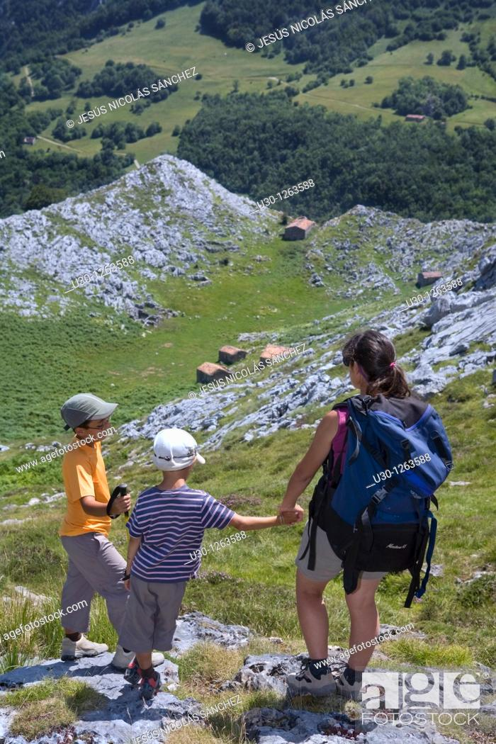 Stock Photo: Family practice mountaineering in the Urrieles massif, in the Picos de Europa National Park, Asturias, Spain.