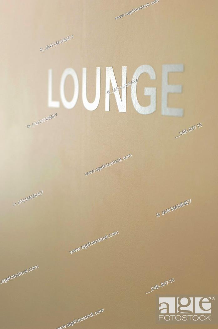 Stock Photo: Single word lounge at wall.