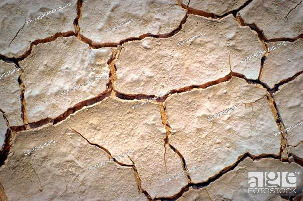 Stock Photo: dry desert cracked ground background.