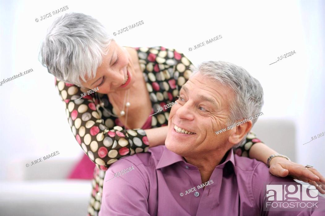 Stock Photo: Portrait of happy senior couple at home.