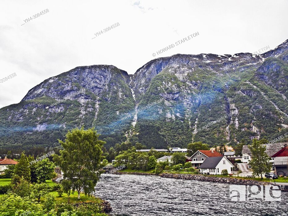 Stock Photo: The Eio river runs through the village of Eidfjord, Norway. Mountains surround the town. The Eio river is only 1. 3 miles long and runs from Lake Eidfjord into.