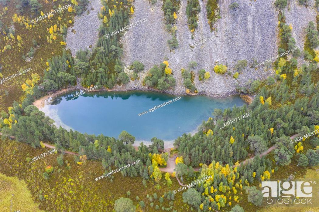 Stock Photo: Autumn aerial view of An Lochan Uaine malso known as the Green Loch due to the striking green colour of it's water in Cairngorms National Park, Scotland, UK.