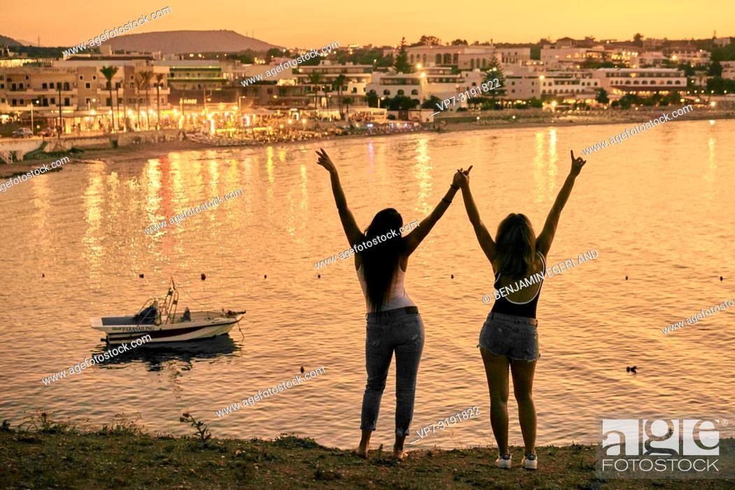 Imagen: two women, friends, seaside, hanging out, together, holiday, in Chersonissos, Crete, Greece.
