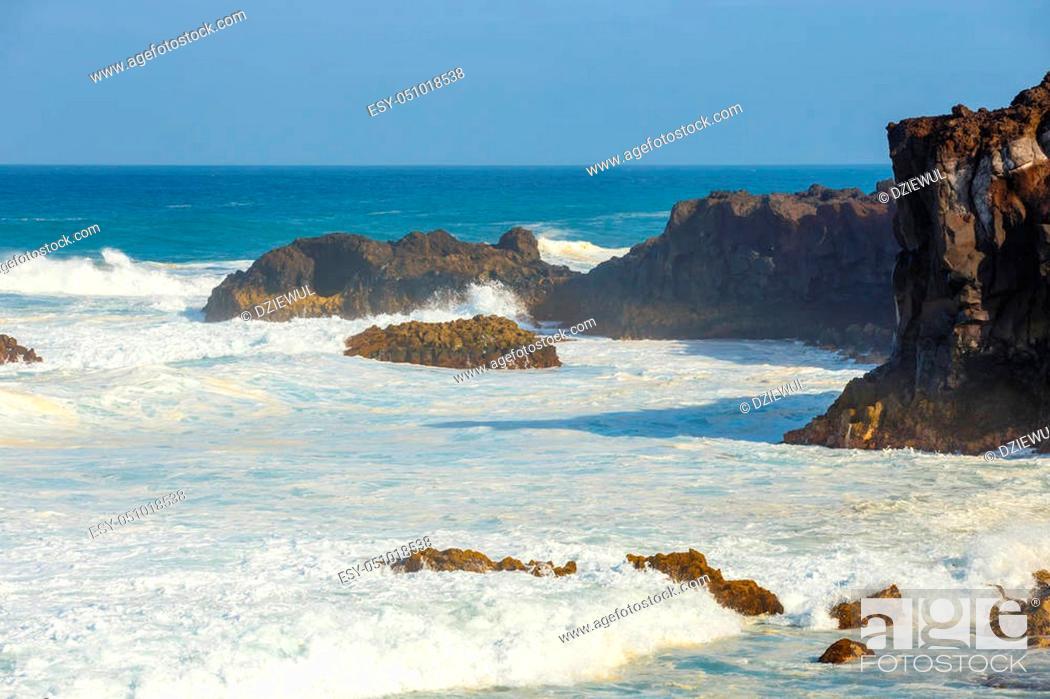 Stock Photo: Los Hervideros, volcanic coastline with wavy ocean and blue sky, Lanzarote island, Spain.